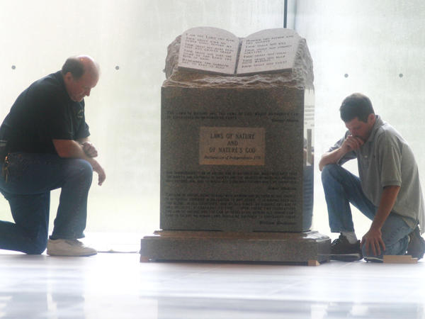 Workers pause in preparation to move the Ten Commandments monument from the rotunda of Alabama's Heflin-Torbert Judicial Building in August 2003.