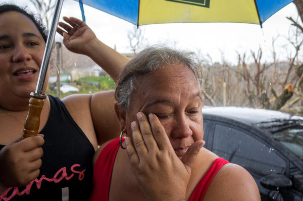 Veronica Vargas (left) and her mother, Martha Viera, rode out the hurricane in their house on the top of a mountain ridge, near Aibonito in central Puerto Rico.