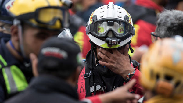 A rescue worker collects himself as others gather around him in Mexico City last week.