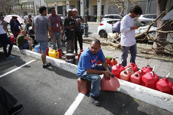 Edgar Morales sits and waits in line to get gas as he deals with the aftermath of Hurricane Maria on Sept. 26, 2017, in San Juan, Puerto Rico. (Joe Raedle/Getty Images)