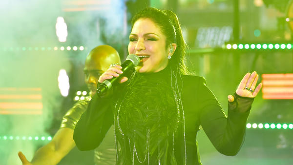 Gloria Estefan (shown here performing in 2016) has had one of the longest and most successful careers of any contemporary pop star, and she has done it in two languages.