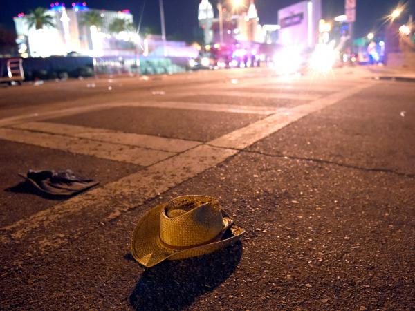 A cowboy hat lies in the street in Las Vegas. The Route 91 Harvest music festival ended in violence and chaos as thousands of people sought to escape an attack from above that they couldn't see.