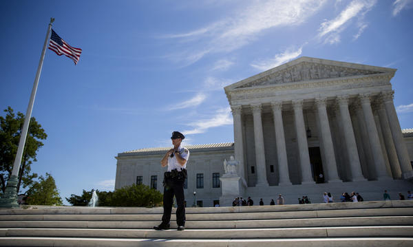 The Supreme Court, pictured in June, opened its new term on Monday. The justices heard arguments in a case about nonunion employees' right to take action against alleged illegality by their employer.