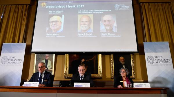 Nobel Committee for Physics members announce the 2017 Nobel Prize winners at the Royal Swedish Academy of Sciences in Stockholm. The laureates are (from left) Rainer Weiss, Barry C. Barish and Kip S. Thorne.