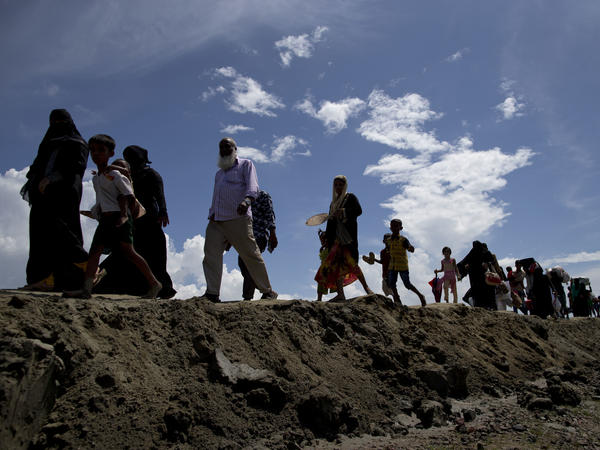 Newly arrived Rohingya Muslims from Myanmar walk to a camp for refugees in Teknaf, Bangladesh, on Monday. Hundreds of thousands of Rohingya refugees have streamed across the border following Myanmarese military retaliation for attacks by a Rohingya militant group.