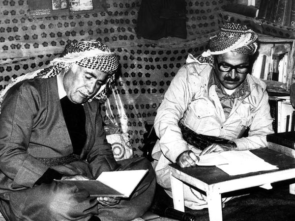 Jalal Talabani (right) sat with a fellow Peshmerga fighter in the mountains of Kurdistan in 1978.