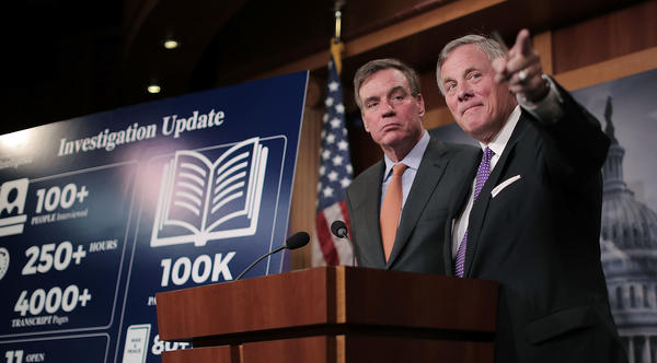 Senate Intelligence Committee Chairman Richard Burr, R-N.C. (right), and committee Vice Chairman Mark Warner, D-Va., hold a news conference Wednesday on the status of the committee's inquiry into Russian interference in the 2016 presidential election.