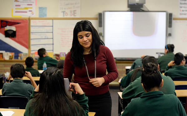 Seventh-grade English teacher Kareli Lizárraga works with her students at STRIVE Prep-Sunnyside in Denver. She came to the United States illegally as a 4-year-old, and works in Denver thanks to the Deferred Action for Childhood Arrivals (DACA) program.