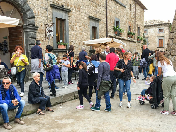 Day-trippers wait in line at one of Civita's few cafés.