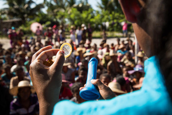 Nurse Olivia Haingoniaina demonstrates how to use a condom as part of a one-day clinic in the village of Ambohitsara.