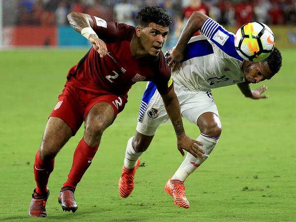 DeAndre Yedlin (left) of United States and Alberto Quintero of Panama fight for the ball during the 2018 FIFA World Cup Qualifying match Friday in Orlando, Fla.