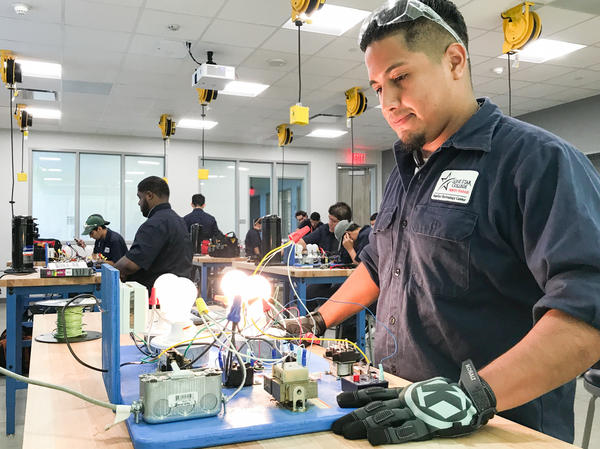 Eric Arjon practices on a circuit board at Lone Star College's new construction trades center in Houston. He is training to become a heating, ventilation and air conditioning technician.