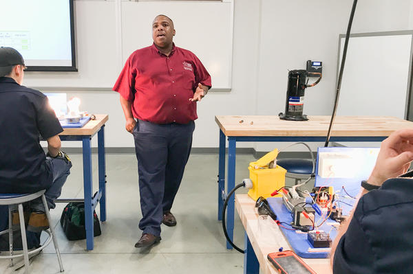 Randy Williams, a former Lone Star College student who now teaches in the HVAC department, says employers have tried to hire his students before they finish their training.