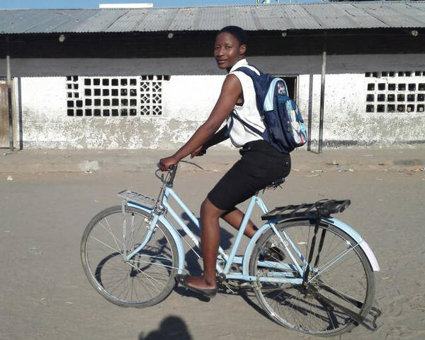 Jenipher Sanni, a former child bride from Malawi, with the bike she used to get to and from school after she left her husband.