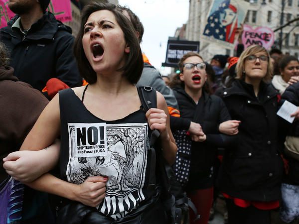 Anti-Trump protesters chant during an Inauguration Day demonstration in Washington, D.C., in January. A judge has narrowed the Justice Department's warrant for records related to a website used to plan protests.
