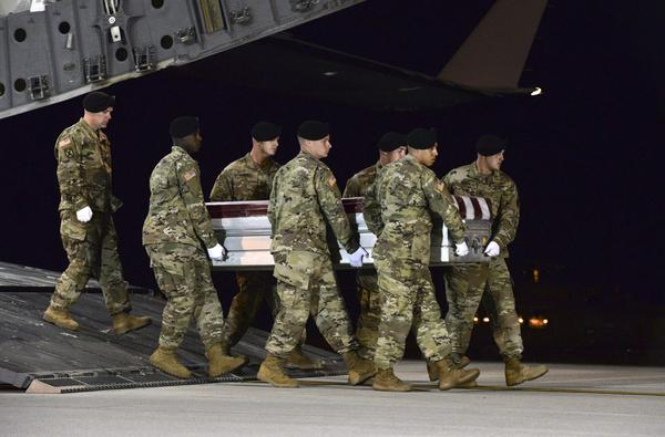 In this image provided by the U.S. Air Force, a U.S. Army carry team transfers the remains of Army Staff Sgt. Dustin Wright of Lyons, Ga., late Thursday, Oct. 5, 2017, upon arrival at Dover Air Force Base, Del. Wright, 29, of Lyons, Ga., was one of four U.S. troops and four Niger forces killed in an ambush by dozens of Islamic extremists on a joint patrol of American and Niger Force. (Staff Sgt. Aaron J. Jenne/U.S. Air Force via AP)