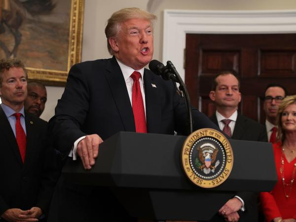 President Trump talks Thursday about an executive order to ease the way for groups of employers to offer health insurance. Later, the administration said it would halt subsidy payments to insurers.