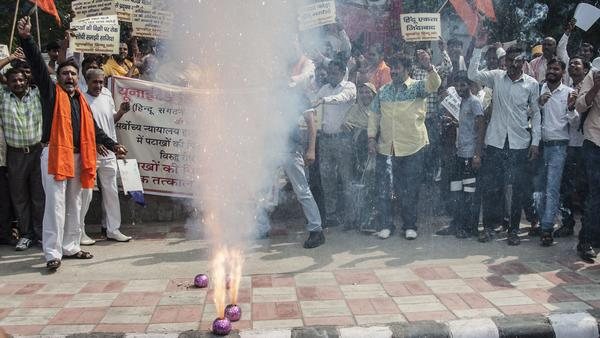 Hindu activists protest against a court-ordered ban on the sale of firecrackers to curtail air pollution in the Indian capital by setting off firecrackers in New Delhi on Friday.