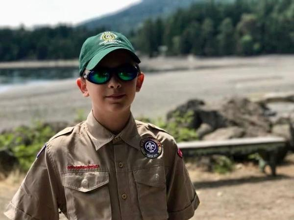 "Boy Scout Charlie Underdown of Seattle says that welcoming girls into the group fits with the Scout Law, which says to be ""trustworthy, loyal, helpful, friendly, courteous, kind, obedient, cheerful, thrifty, brave, clean and reverent."""