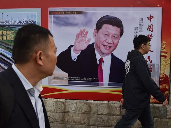 "A poster in Beijing features Chinese President Xi Jinping and a slogan reading ""Chinese Dream, People's Dream."" Xi is preparing to embark on a second five-year term this week."