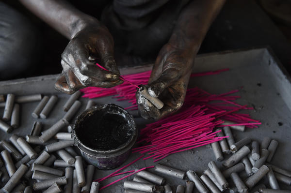 A worker prepares firecrackers at a workshop on the outskirts of Ahmedabad.