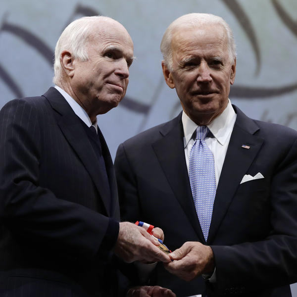 Sen. John McCain, R-Ariz., receives the Liberty Medal from former Vice President Joe Biden, chairman of the National Constitution Center's Board of Trustees, in Philadelphia on Monday.