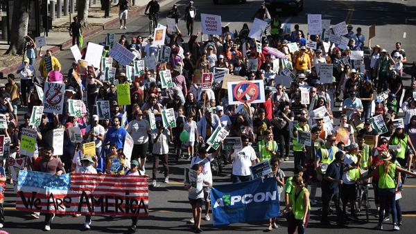 "People marching in the ""#NoMuslimBanEver"" rally in downtown Los Angeles on Sunday. Organized by the Council on American-Islamic Relations, the march was in response to President Trump's most recent travel ban, which has now been partially blocked by a federal judge in Hawaii."