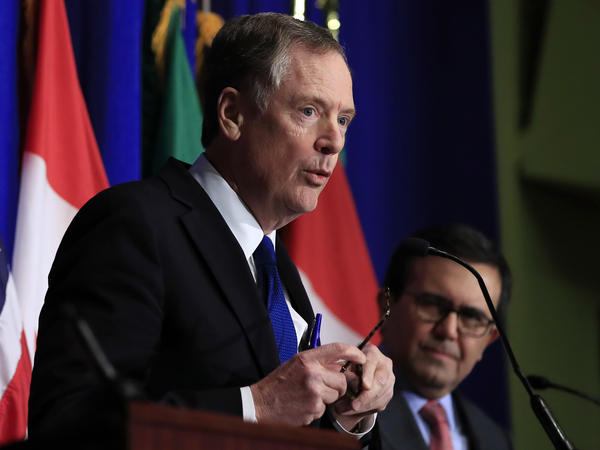 United States Trade Representative Robert Lighthizer (left) speaks Tuesday at the end of the latest round of negotiations over the North American Free Trade Agreement in Washington, as Mexico's economy minister, Ildefonso Guajardo, looks on.