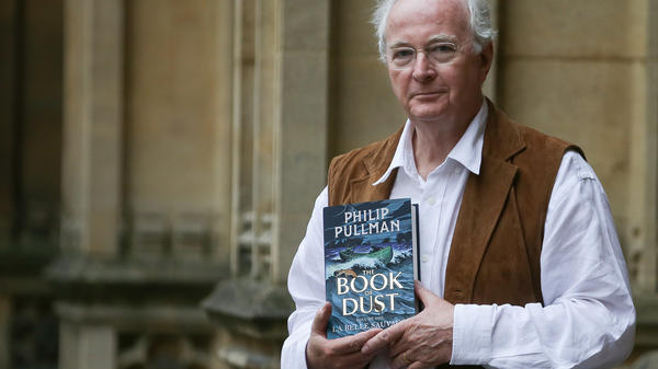 Author Philip Pullman poses with his new book at Oxford's Bodleian Libraries — where he has been known to do research.