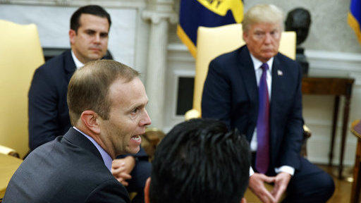 President Trump and Puerto Rico Gov. Ricardo Rossello listen as FEMA Administrator Brock Long speaks during a meeting in the Oval Office on Thursday.