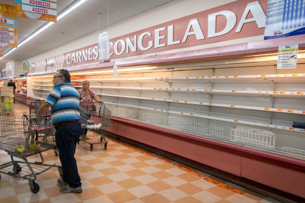 Shoppers find empty frozen meat shelves in a Mr. Special Supermarket in Lares.