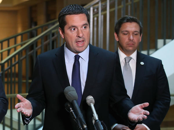 House Intelligence Committee Chairman Devin Nunes, R-Calif., speaks while flanked by and Rep. Don DeSantis, R-Fla., as he announces that his committee and the House oversight committee are starting an investigation into a 2010 deal between Russia and the Obama Administration.