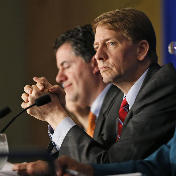"Consumer Financial Protection Bureau Director Richard Cordray, shown last October at a panel discussion in Richmond, Va., called Tuesday's vote ""a giant setback for every consumer in this country. Wall Street won and ordinary people lost."""
