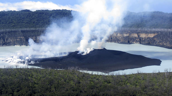 Residents of Ambae, in Vanuatu, are beginning to return home this week. In this photo from Oct. 1, that was provided by the Vanuatu Meteorological and GeoHazards Department, the volcanic cone is seen that formed in Lake Vui near the summit of Ambae Island.