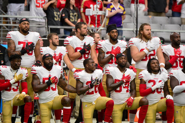 Members of the San Francisco 49ers kneel during the national anthem prior to a game against the Arizona Cardinals at University of Phoenix Stadium on Oct. 1.