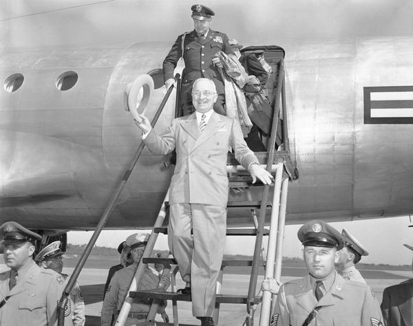President Harry Truman walks down a plane ramp upon his arrival in Kansas City on Sept. 29, 1949. (AP Photo)