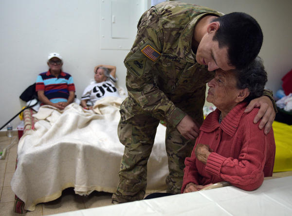 Teresa Colon of Aibonito hugs Staff Sgt. Eric Reyes. She has Alzheimer's and thought he was her grandson. He played along.