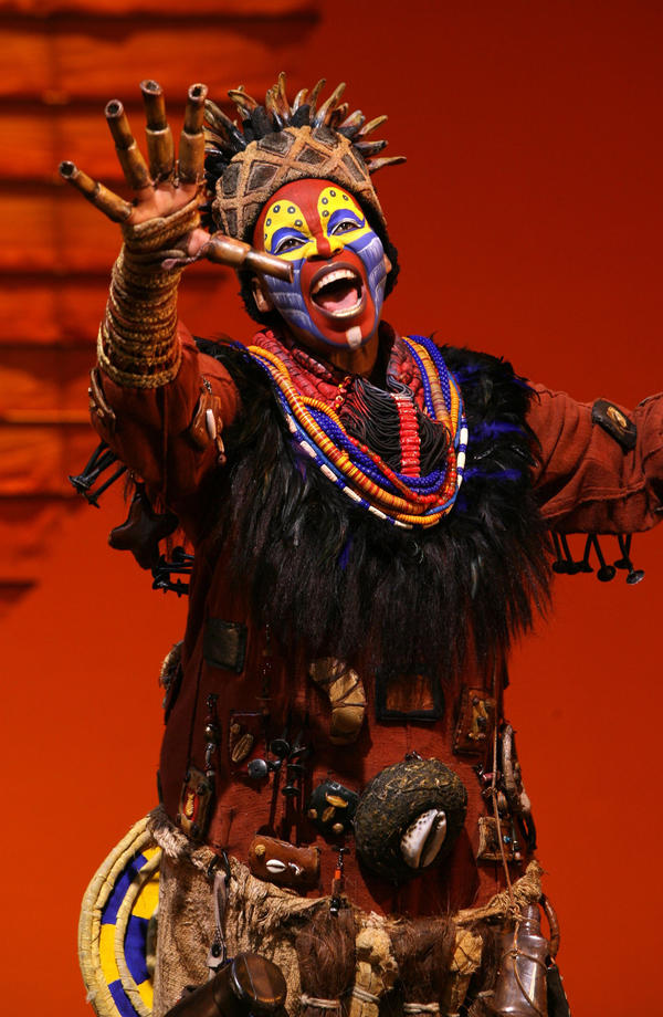Tshidi Manye performs as Rafiki.