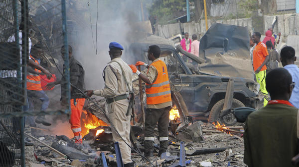 Somali soldiers inspect the wreckage of vehicles after an attack claimed by al-Shabab left at least 23 dead in Mogadishu on Saturday.