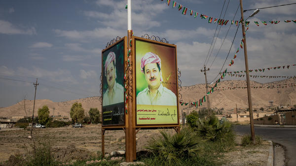 A portrait of Kurdish President Massud Barzani looks out over Alqosh, Iraq.