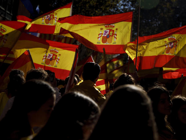 Demonstrators march with Spanish flags during a rally against Catalonia's declaration of independence in Barcelona on Sunday.