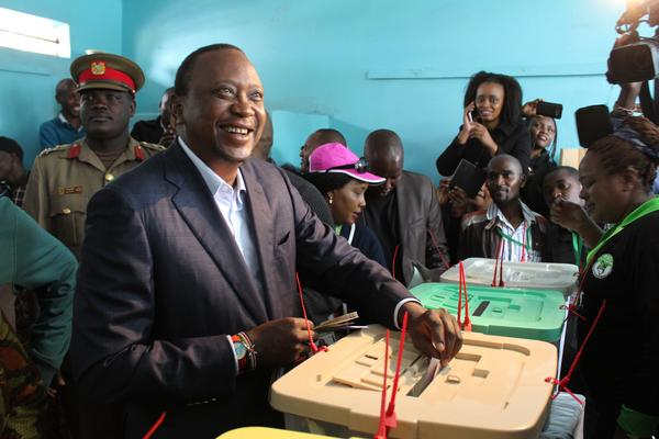 President Uhuru Kenyatta casts his vote during the general elections. Kenyatta was the declared the winner of the disputed rerun of Kenya's presidential election.