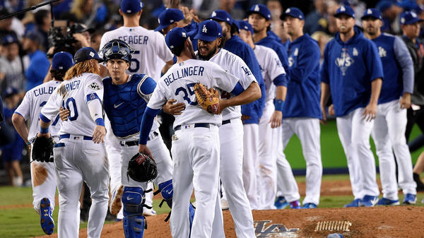 The Los Angeles Dodgers pour onto the field after beating the Houston Astros in Game 6 of the World Series.