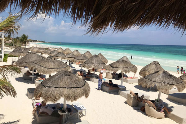 Tourists enjoy the beach in Tulum National Park in Mexico's Riviera Maya region. Some travelers have raised concerns about safety at some resorts in the region, including in a forum post on TripAdvisor this summer asking about blackouts and the risk of assault, rape or robbery.