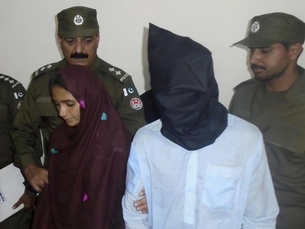 Aasia Bibi and her boyfriend, Shahid Lashari, are presented to journalists at a police station in Muzaffargarh, Pakistan, on Monday.