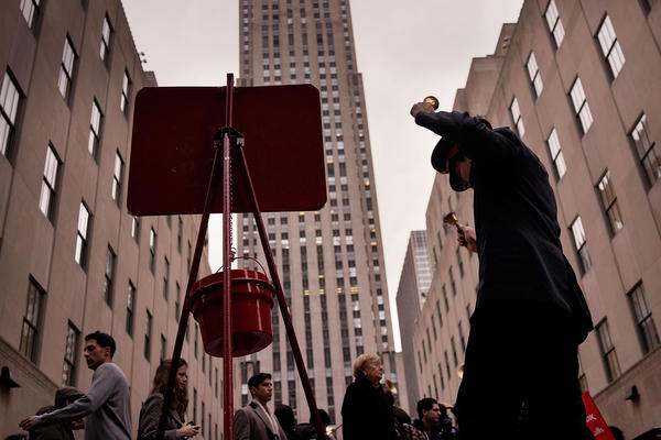 A bell ringer with the Salvation Army in New York City in 2014. Nonprofit groups estimate that the new tax bill proposed by House Republicans could reduce charitable giving by $13 billion annually.