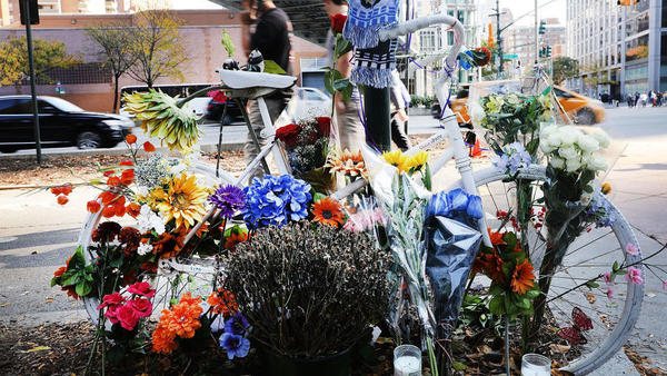 Flowers are placed on a bike at a memorial on Thursday at the scene of Tuesday's terrorist attack along a bike path in Lower Manhattan.