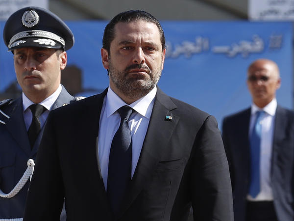 Lebanese Prime Minister Saad Hariri, center, in October arriving for a mass funeral of 10 Lebanese soldiers at the Lebanese Defense Ministry.