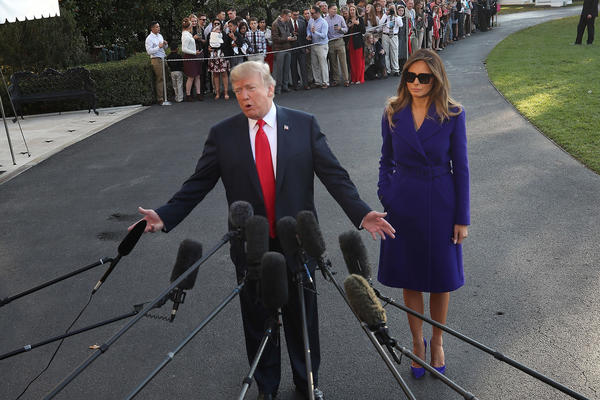 President Trump talks to the media before he and first lady Melania Trump depart from the White House on Marine One on Friday.