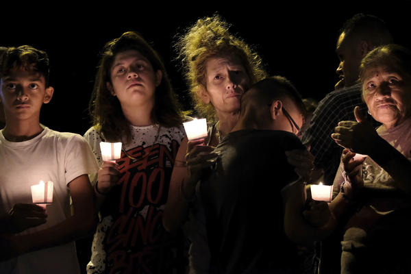 From left are Christopher Rodriguez, Esmeralda Rodriguez, Mona Rodriguez, Jayanthony Hernandez, 12, and Juanita Rodriguez participate in a candlelight vigil for the victims of a fatal shooting at the First Baptist Church in Sutherland Springs, Texas, Sunday.